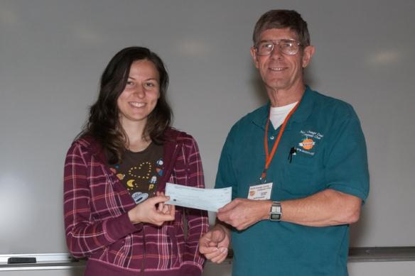 Erin Bela receives a NOCCC grant form President Jim Sanders